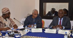 Mr. Appolinaire KI (r) presides over the Tech Committee meeting